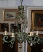 A green painted metal chandelier