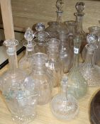 A collection of cut glass decanters and stoppers