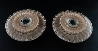 A pair of Rene Lalique Dahlia pattern frosted glass candleholders, Model 2114, 1930's, each of