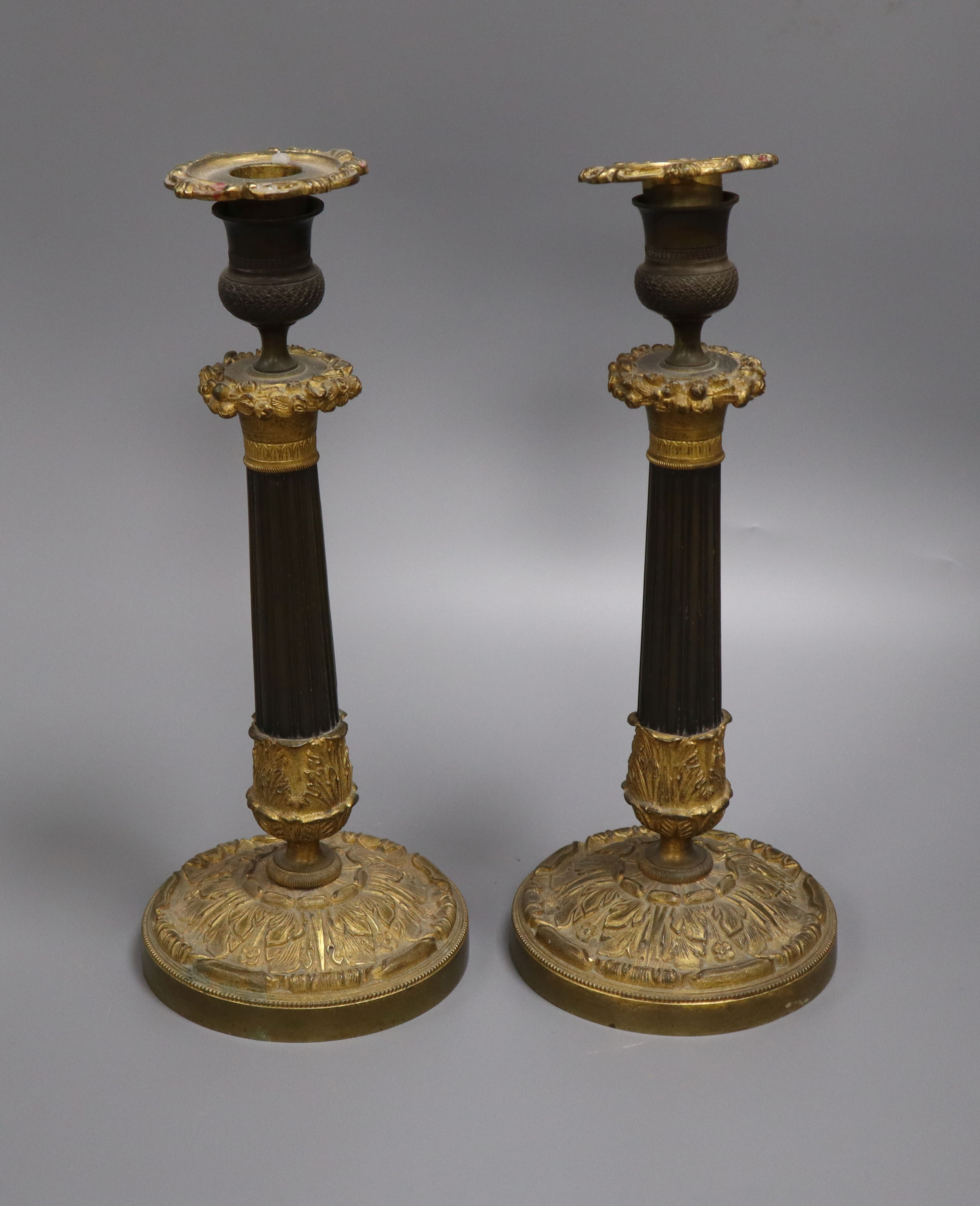 Lot 32 - A pair of William IV bronze and ormolu candlesticks height 30cm