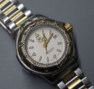 A ladys' Tag Heuer 200M Professional stainless steel and gilt wristwatch
