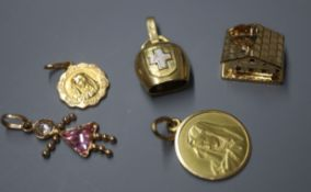 Four 18ct gold charms, comprising a cow bell, a chalet and two Madonnas and a 9ct gold gem-set