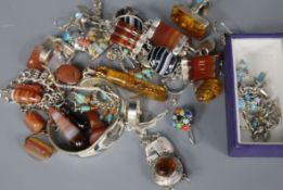 A collection of silver and white metal jewellery, variously set with amber, hardstones, enamels