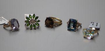 Five 9ct gold gem-set dress rings, including mystic topaz and blueberry quartz examples