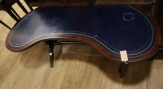 A leather top mahogany kidney shape coffee table W.128cm