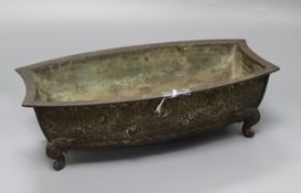 A Japanese Meiji bronze bonsai planter of shaped rectangular form cast with shells, on scrolled