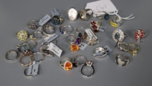A collection of 54 silver and silver gilt gem-set rings and a pair of similar hoop earrings