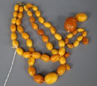 A double strand amber choker necklace and other loose amber, gross weight 81 grams, necklace 36cm.