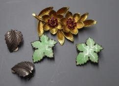 A yellow metal and ruby set leaf brooch and two pairs of white metal earrings including enamel.