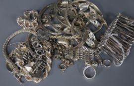 A modernist silver flexible bracelet and a collection of silver and white metal jewellery, including