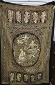 A Burmese large Kalaga wall tapestry, profusely decorated with deities and dragons in panels with