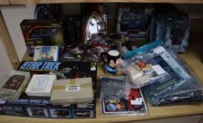 Star Trek action figures, models kits, communicator pins and Franklin Mint prop phaser and