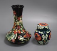A Moorcroft clematis vase and a poppy jar and cover tallest 20cm
