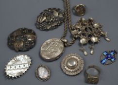 A group of mixed silver and white metal jewellery including a Victorian locket and an antique signet