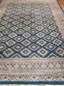 A teal ground Persian design carpet 366 x 270cm