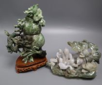A Chinese jadeite 'dragon' carving and a jadeite group largest 21cm