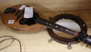 A 19th century mandolin with label Giovani Demeglio and an oak porthole wall mirror from SS