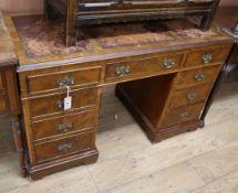 A Georgian style walnut pedestal desk W.120cm