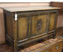 A 1920's panelled oak coffer W.92cm