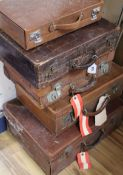 Five vintage leather suitcases largest 56cm