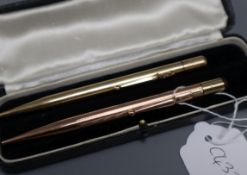 A 9ct gold cased pencil and one other yellow metal case pencil