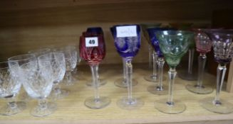 A group of coloured hock glasses and cut glass goblets