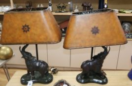 """A pair of bronze """"elephant"""" lamps on marble base overall height 66cm"""