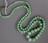 A single strand graduated jade bead necklace, with marcasite set sterling clasp, 68cm.