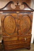 A George III Channel Islands style mahogany linen press, converted to a hanging wardrobe W.128cm