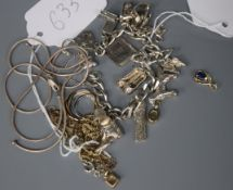 A white metal charm bracelet with 13 charms, an Armani negligee necklace and five other items of