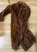 A Bourne & Hollingsworth full-length dark mink coat, another fur coat and a fur stole (3)