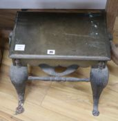 A 19th century brass and wrought iron footman