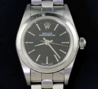 A lady's late 1990's stainless steel Rolex Oyster Perpetual wrist watch, with black dial and baton