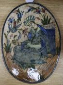 A Persian fritware oval plaque, Qajar dynasty