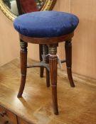 A Regency mahogany adjustable piano stool