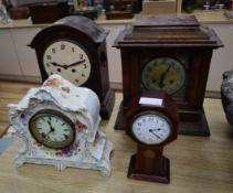 Four assorted wood and ceramic mantel clocks tallest 38cm