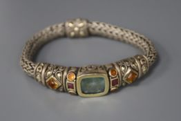 An Indian? white and yellow metal, coloured stone set bracelet.