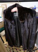 A dark brown mink jacket with a Grosvenor Harrods label