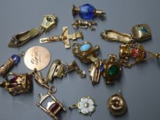 A 9ct gold crucifix pendant and a collection of nineteen 9ct gold charms, various, including a