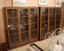 A near pair of mahogany glazed bookcases Larger 160cm