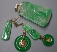 A carved jade pendant of tapered rectangular form, a similar pair of earrings and two jade bi-disc