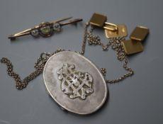 A pair of 9ct. gold rectangular cufflinks, a bar brooch, a silver locket on chain.