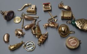 A pair of 9ct gold plain drop earrings and nineteen 9ct gold charms, various, including a jade