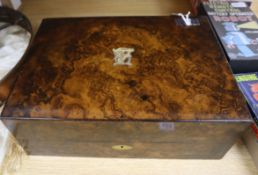 A burr walnut jewellery-cum-writing box, retailed by Thomas, 153 New Bond Street, London, having