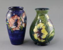 A Moorcroft 'anemone' vase and a similar 'hibiscus' vase, 1950/60's, impressed marks Moorcroft,