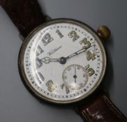 A gentleman's George V silver Waltham manual wind wrist watch, on leather strap.