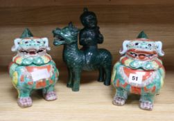 A pair of Chinese lion dog censers and covers and a pottery figure of a boy riding a qilin
