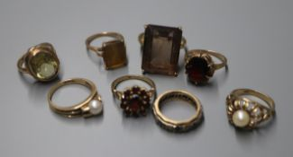 Eight assorted 9ct and gem set dress rings, including smoky quartz, cultured pearl and garnet.