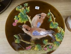 A pair of Schuz Cilli wall dishes, decorated with birds diameter 44cm