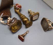 Five assorted 19th century yellow metal overlaid or gilt metal and gem set seals, largest 72mm.